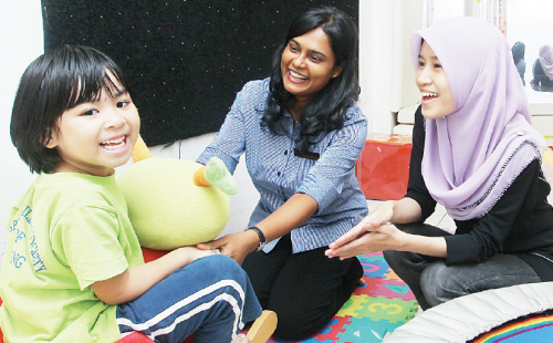 Jasmine Manuel (centre) and Cikgu Ayu of the Special Children Society of Ampang have a special bond with their students at the school.